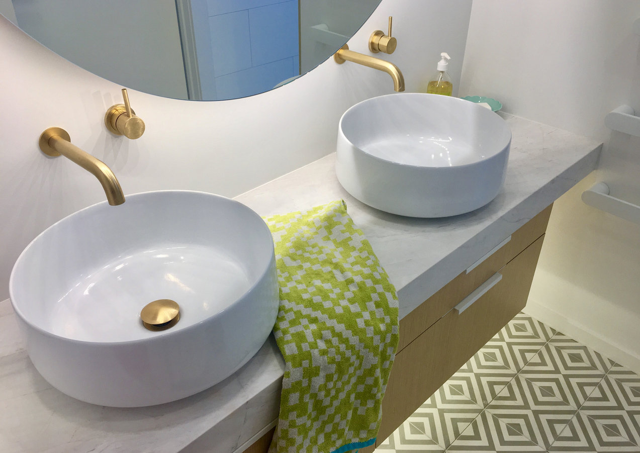 Double vessel basins on a marble top