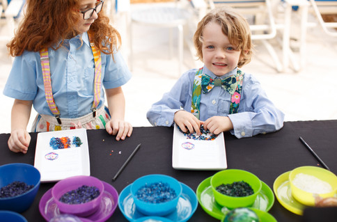 Kids pick out their colors at their glassblowing class poolside at the Ritz Carlton Naples