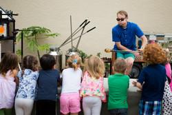 Children Gathered around Glassblower