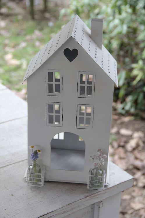 Casa cuore con davanzali