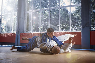 judo-fighters-showing-technical-skill-wh