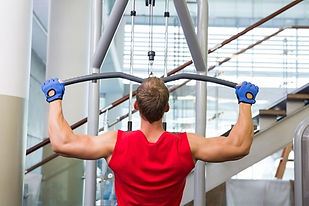 Man using lat pull down machine. Gym maintenance in Broward County, Gym maintenance in Coconut Creek, Gym maintenance in Cooper City, Gym maintenance in Coral Springs, Gym maintenance in Dania Beach, Gym maintenance in Davie, Gym maintenance in Deerfield Beach, Gym maintenance in Fort Lauderdale, Gym maintenance in Hallandale Beach, Gym maintenance in Hillsboro Beach, Gym maintenance in Hollywood, Gym maintenance in Lauderdale Lakes, Gym maintenance in Lauderdale-by-the-Sea, Gym maintenance in Lauderhill, Gym maintenance in Lighthouse Point, Gym maintenance in Margate, Gym maintenance in Miramar, Gym maintenance in Oakland Park, Gym maintenance in Parkland, Gym maintenance in Pembroke Park, Gym maintenance in Pembroke Pines, Gym maintenance in Plantation, Gym maintenance in Pompano Beach, Gym maintenance in Southwest Ranches, Gym maintenance in Sunrise, Gym maintenance in Tamarac, Gym maintenance in Weston, Gym maintenance in Wilton Manors, gym uphol