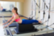 Women stretching on pilates reformer.Pilates Equipment Maintenance in Broward, Palm Beach