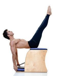 Man stretching on pilates stability chair.Pilates Reformer Service and Maintenance in Broward,