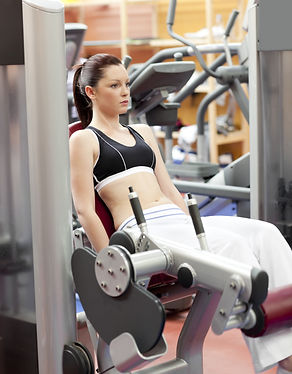 Female using leg extension machine.Fitness Equipment Repair and Gym Maintenance Service For Hotels, Hospitals, Condo Associations, Police Stations, Fire Stations, Schools, Cruise Lines, Corporate Fitness Centers, Pilates Studios, Rehab Facilities, Recreation Centers, Health Clubs, Spas, Resorts, Physical Therapy Centers, Apartment Fitness Centers, Condo Fitness Centers, Municipalities, Country Clubs