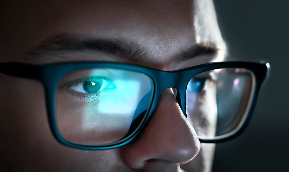 Computer screen light reflect from glass