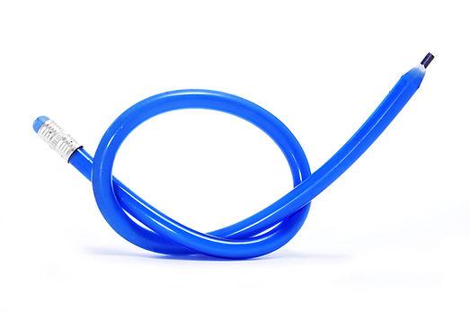a blue flexible pencil on a white backgr