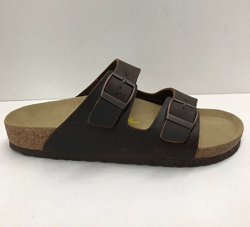 Jool Kakota in brown leather