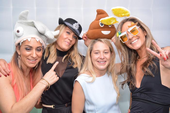 4 Ladies wearing props enjoying the photo boot at a Bar Mitzvah