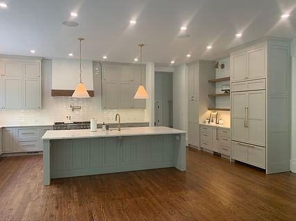 front view of grey kitchen renovation with floor to ceiling cabinetry and kitchen island with built in sink