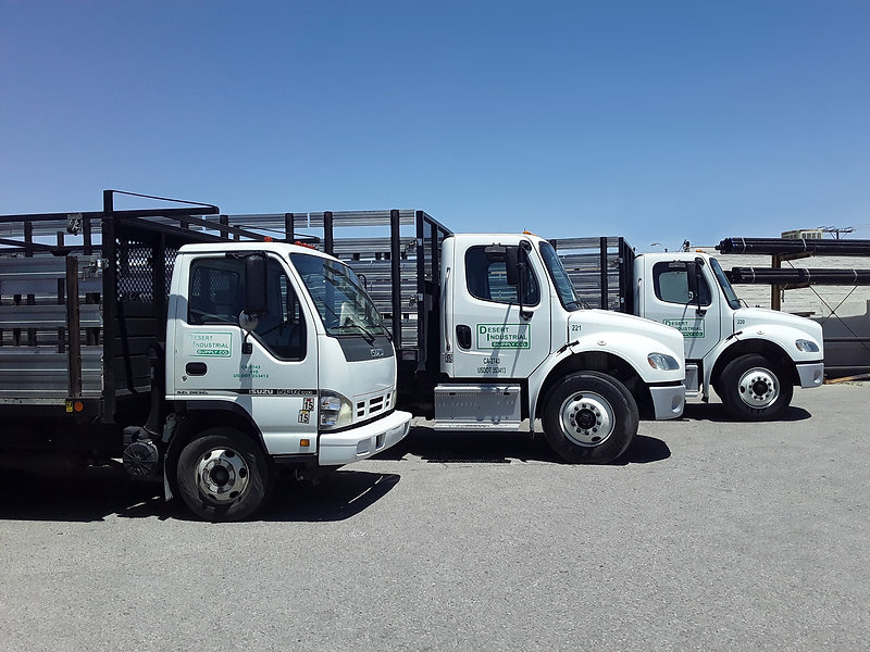 Fleet of Desert Industrial Supply Co plumbing work vehicles