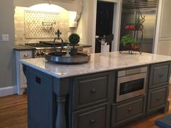 dark grey kitchen island with custom built in microwave kitchen remodeling contractors