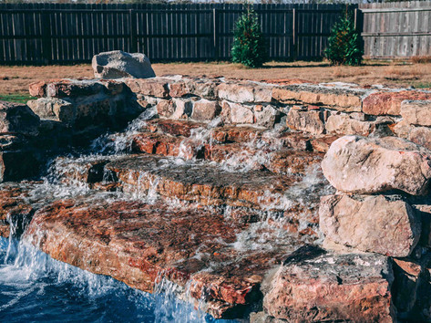 Pool waterfall built by Butler Pool and Spa