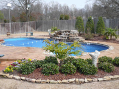 fiberglass pool with water fall built by Butler Pool and Spa
