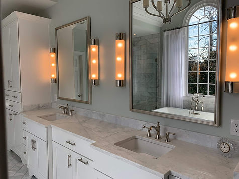 grey bathroom renovation project  with double sinks and marble countertops