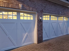 Residential garage doors at night. Installed by Dodson Garage Doors, LLC of Birmingham, AL