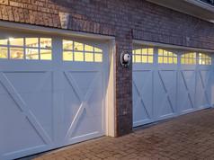 Residential garage doors at night. Installed by Dodson Garage Doors, LLC of Birmingham, AL