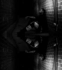 Rapper NiccoFeem sitting in a dark alley