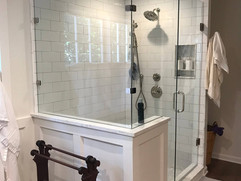 bathroom renovation with large white shower and glass surround