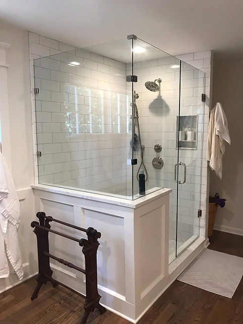 bathroom remodeling project with glass surround and white subway tile
