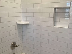 bathroom renovation with tiled shower and bathtub combo