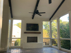 Deck remodeling with outdoor fireplace