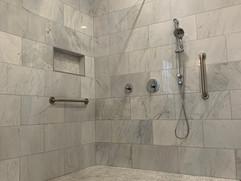 bathroom renovation with grey tiled shower