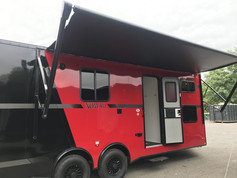 red and black trailer with awning
