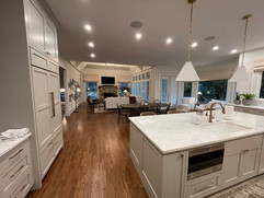 kitchen remodeling project with custom island with built in sink and microwave
