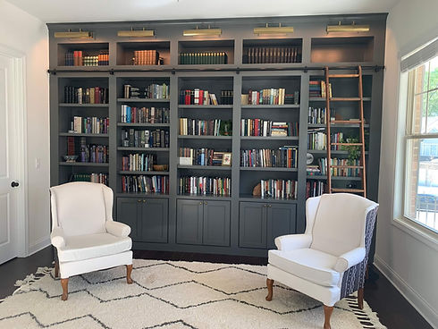 Built in library in sitting room of whole home remodel