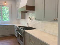 kitchen remodel with stove and custom range hood