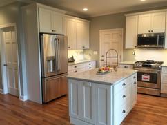 white kitchen remodel with large white kitchen island
