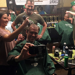 Invisors shave head for St. Baldricks foundation fundraising