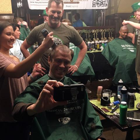 Invisors shave head for St. Baldricks foundation fundraising