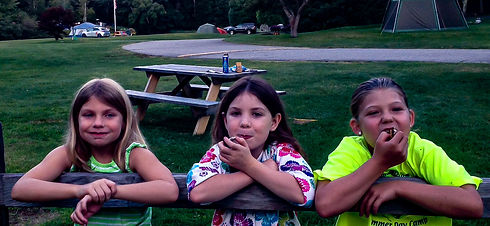Three girls eating smores