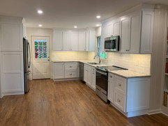 front view of kitchen remodel with custom cabinetry built around fridge