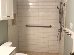 bathroom renovation with tiled floor and tiled shower