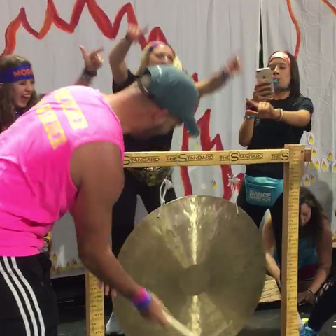man hitting Gong cymbal