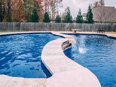 fiberglass pool with waterfall built by Butler Pool and Spa