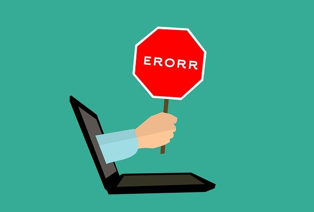 hand coming out of computer holding error sign symbolizing broken web design