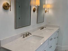 double sink with double mirrors and grey cabinets bathroom renovation
