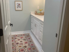 entrance view of renovated bathroom with tiled floor