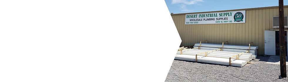 Outdoor shot of Desert Industrial Supply plumbing supply warehouse with supplies