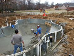 Butler pool and spa pool builder crew digging hole for pool