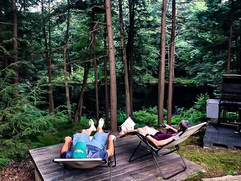 Campers relaxing in chairs