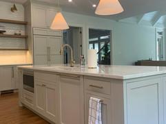 kitchen remodel with kitchen sink inside of custom island