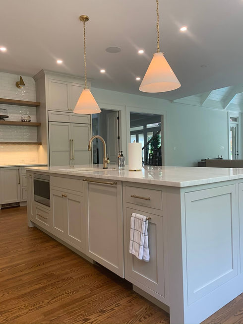 kitchen renovation project with large grey kitchen island with built in sink and microwave