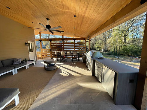 covered deck remodel with outdoor kitchen
