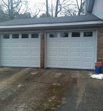 Two white garage doors with windows