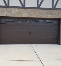 Brown garge door with windows